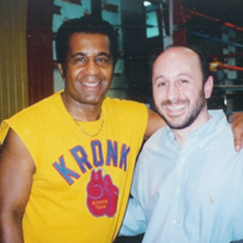 Dr. DeMartino posing with Emanuel Steward