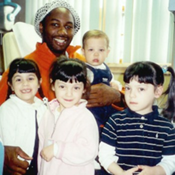 Lennox Lewis posing with Dr. DeMartino's children