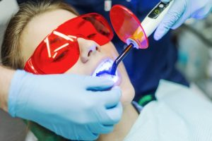 A woman receiving laser dentistry.