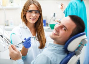 Man in dental chair for exam