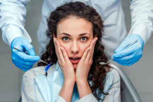 Woman with shocked expression at dentist office