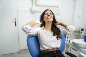 Smiling woman relaxes at the dentist with sedation dentistry in Phillipsburg