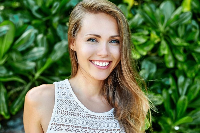 young woman showing off healthy smile